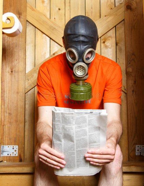 man-gas-mask-sitting-toilet-newspaper-finland-57244242.jpg
